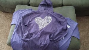 The color is heather gray.  The hoodie is very lightweight.